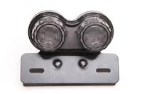 Стоп-сигнал светодиодный универсальный тонированный круг (со встроеными поворотниками,стоп,габарит и подсветка номера)